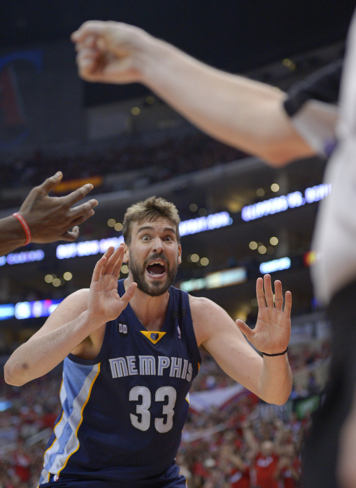 Photo - Memphis Grizzlies center Marc Gasol, of Spain, yells to referee Mike Callahan during the second half of Game 2 of a first-round NBA basketball playoff series, Monday, April 22, 2013, in Los Angeles.  (AP Photo/Mark J. Terrill)