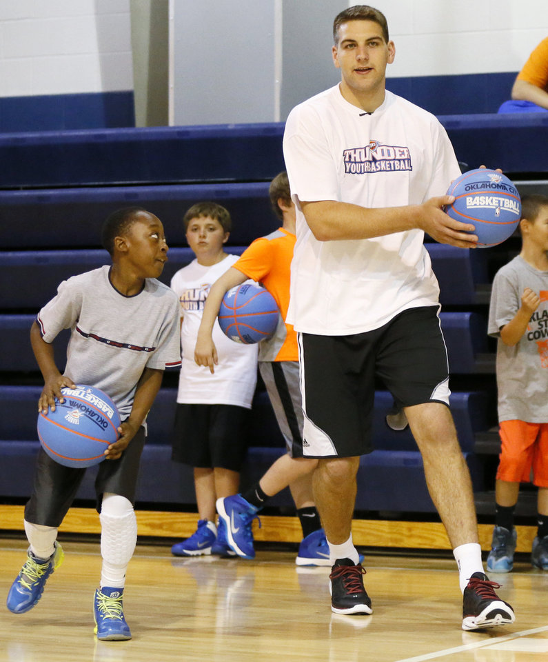 Photo - Thunder player Mitch McGary leads a drill during a visit to Thunder Youth Basketball Camp at Casady School in Oklahoma City, Wednesday, July 16, 2014. Photo by Nate Billings, The Oklahoman