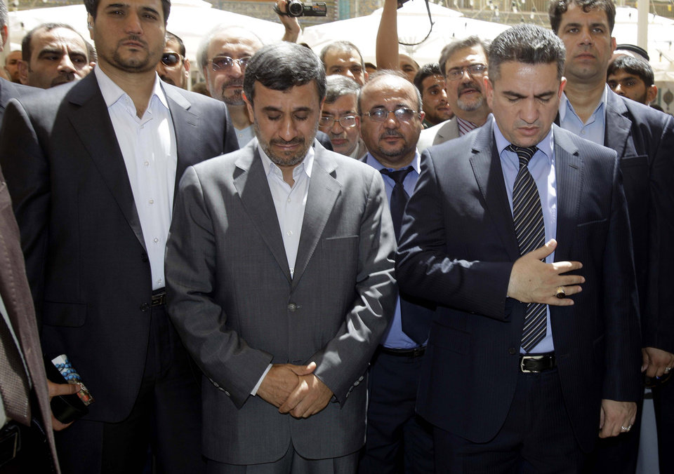 Iranian President Mahmoud Ahmadinejad, center, reacts during his visit to the Imam Ali shrine in Najaf, Iraq, Friday, July 19, 2013. The outgoing Iranian president�s visits to the cities of Najaf and Karbala during the Islamic holy month of Ramadan followed meetings with top Iraqi officials in Baghdad on Thursday that highlighted the tightening bonds between Shiite-led Iraq and Iran. (AP Photo/Karim Kadim, Pool)