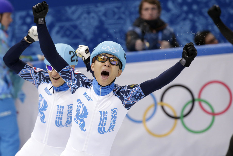 Photo - Victor An of Russia, right, celebrates winning in a men's 1000m short track speedskating final alongside Vladimir Grigorev of Russia, who placed second, at the Iceberg Skating Palace during the 2014 Winter Olympics, Saturday, Feb. 15, 2014, in Sochi, Russia. (AP Photo/Bernat Armangue)