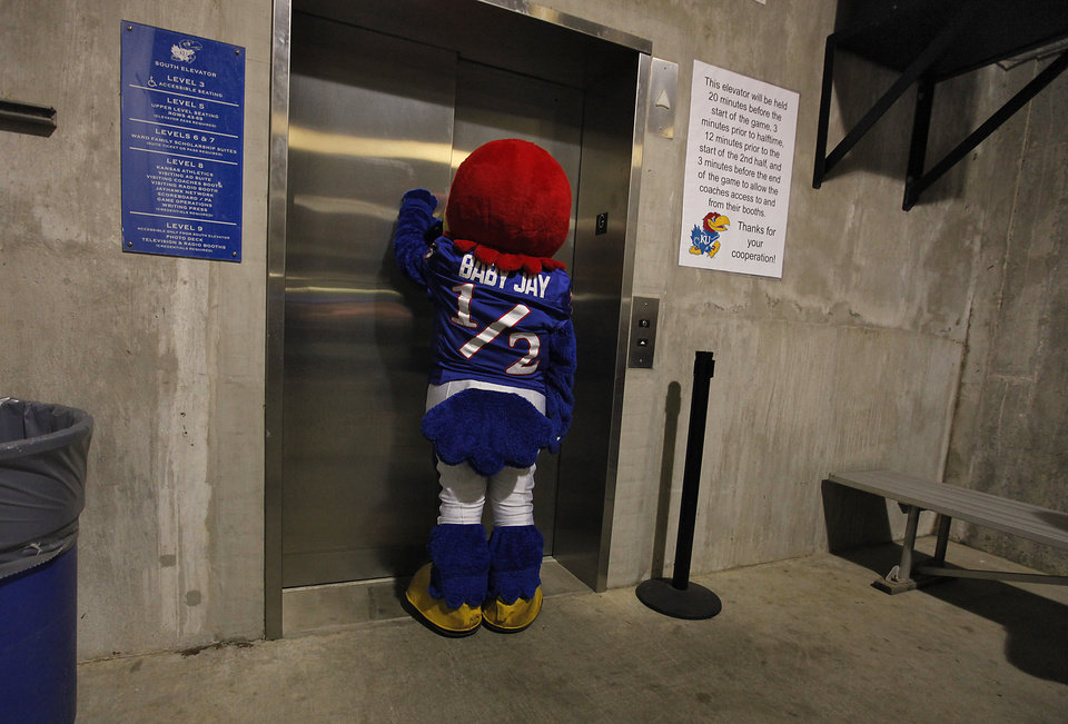 Photo - Kansas' Baby Jay waits for the elevator during the college football game between the University of Oklahoma Sooners (OU) and the University of Kansas Jayhawks (KU) on Saturday, Oct. 15, 2011. in Lawrence, Kan. Photo by Chris Landsberger, The Oklahoman