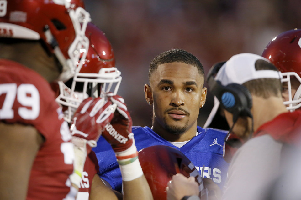 Photo - Oklahoma's Jalen Hurts listens during a timeout in the University of Oklahoma's (OU) spring football game at Gaylord Family-Oklahoma Memorial Stadium in Norman, Okla., Friday, April 12, 2019. Photo by Bryan Terry, The Oklahoman