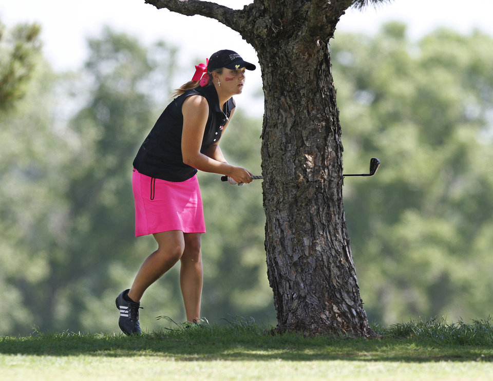 Photo - GIRLS HIGH SCHOOL GOLF / STATE TOURNAMENT: Duncan High School golfer Amanda Johnson looks down the fairway after hitting her ball out of  the rough after it landed under this tree during Girls Class 5A State Golf Tournament at Lincoln Park Golf Course on Wednesday, May 2,  2012.    Photo by Jim Beckel, The Oklahoman