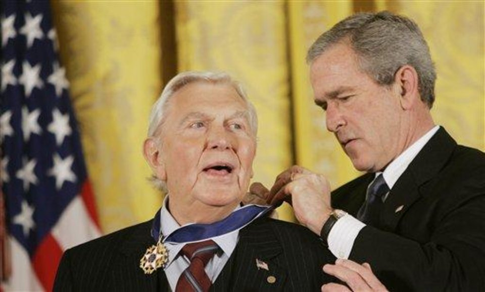 "FILE - This Nov. 9, 2005 file photo shows President Bush presenting the Presidential Medal of Freedom to actor Andy Griffith in the East Room of the White House. Griffith, whose homespun mix of humor and wisdom made ""The Andy Griffith Show"" an enduring TV favorite, died Tuesday, July 3, 2012 in Manteo, N.C. He was 86. (AP Photo/Evan Vucci, file)"