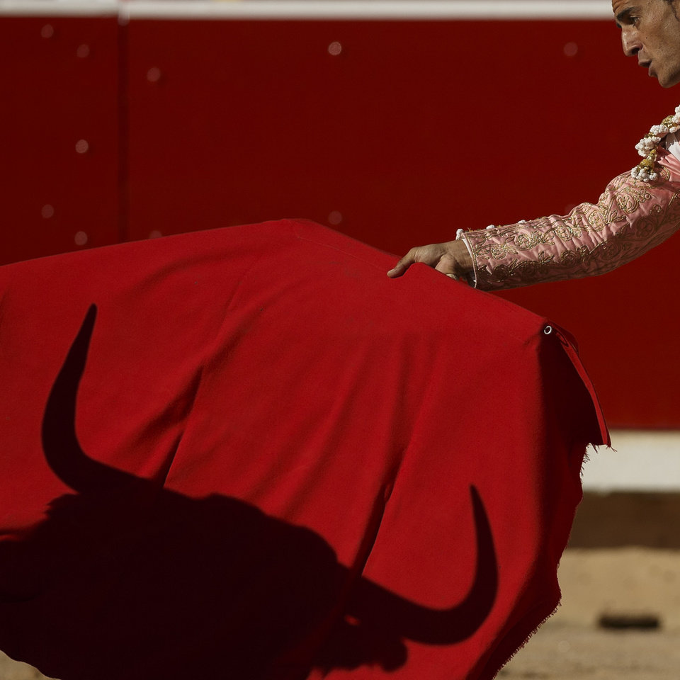 Photo - Spanish bullfighter Ivan Fandino performs during a bullfight of the San Fermin festival, in Pamplona, Spain, Wednesday, July 9, 2014. Revelers from around the world arrive in Pamplona every year to take part on some of the eight days of the running of the bulls glorified by Ernest Hemingway's 1926 novel