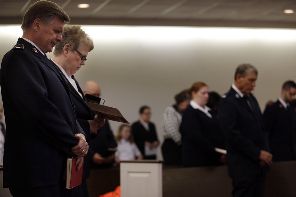 Photo - Commissioners David and Barbara Jeffery pray Saturday during the Salvation Army Central Oklahoma Soldiers' Rally in Oklahoma City. Photo by Sarah Phipps, The Oklahoman  SARAH PHIPPS - THE OKLAHOMAN