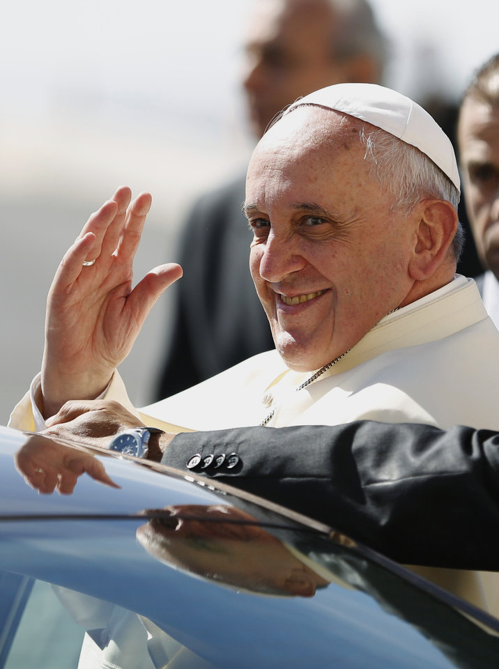 Photo - Pope Francis waves upon his arrival at the West Bank town of Bethlehem on Sunday, May 25, 2014. Pope Francis landed Sunday in the West Bank town of Bethlehem in a symbolic nod to Palestinian aspirations for their own state as he began a busy second day of his Mideast pilgrimage. (AP Photo/Mohamad Torokman, Pool)