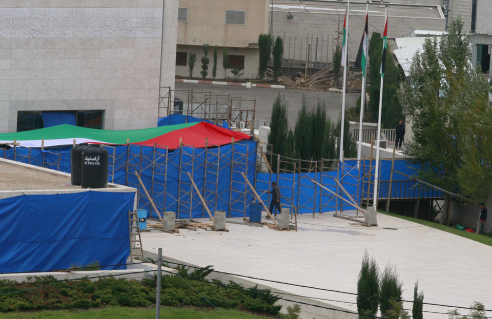 Blue tarp covers the entrance to Yasser Arafat\'s mausoleum in the West Bank city of Ramallah. The remains of the late Palestinian leader Yasser Arafat were exhumed from his grave on Tuesday so international forensic experts could search for additional clues to his death, Palestinian officials said. (AP Photo/Nasser Shiyoukhi)