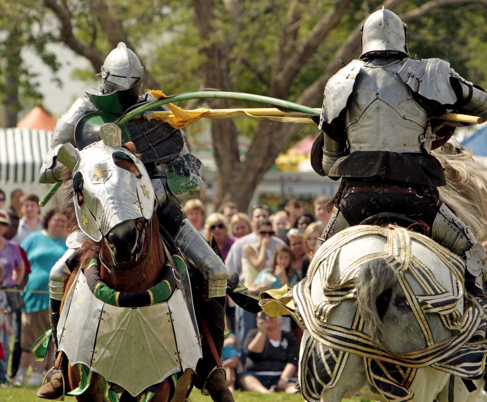 Sir Jacob (left) is unseated by Sir Maxwell during jousting at the Medieval Fair on Friday, March 30, 2012, in Norman, Okla.  Photo by Steve Sisney, The Oklahoman