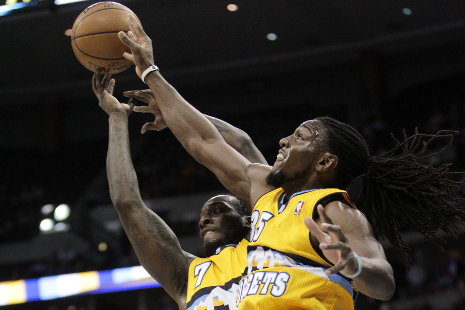 Photo - Denver Nuggets' J.J. Hickson (7) and  Kenneth Faried (35) go up for a rebound against the Oklahoma City Thunder during the first quarter of an NBA basketball game, Thursday, Jan. 9, 2014, in Denver. (AP Photo/Barry Gutierrez)