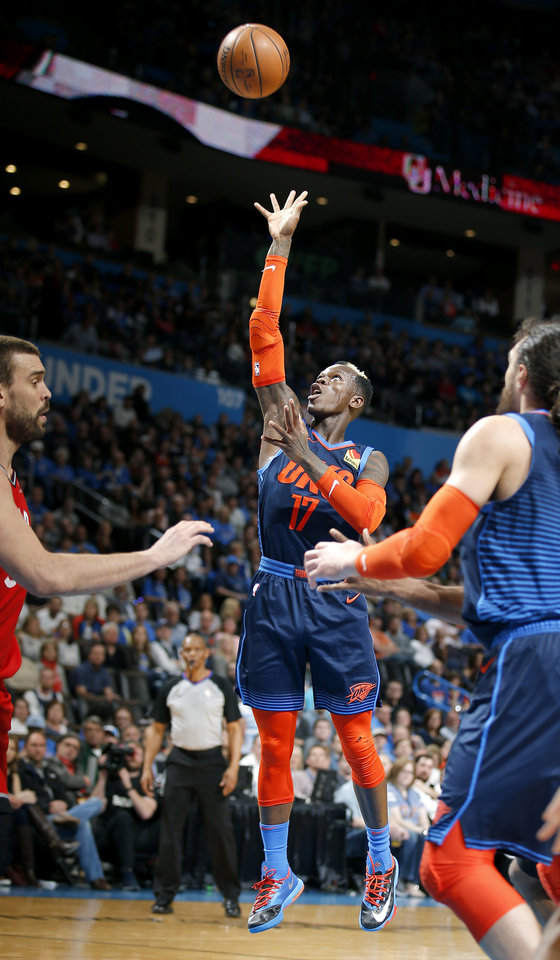Photo - Oklahoma City's Dennis Schroder (17) shoots during the NBA basketball game between the Oklahoma City Thunder and the Toronto Raptors at the Chesapeake Energy Arena, Wednesday,March 20, 2019. Photo by Sarah Phipps, The Oklahoman