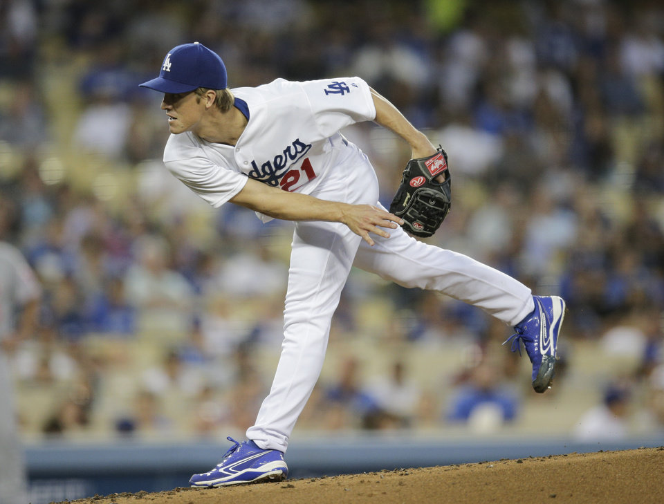 Photo - Los Angeles Dodgers starting pitcher Zack Greinke follows through on a pitch to the Cincinnati Reds during the fourth inning of a baseball game Tuesday, May 27, 2014, in Los Angeles. (AP Photo/Jae C. Hong)