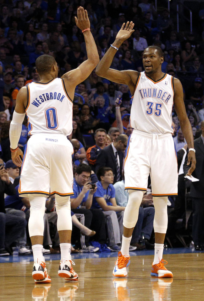 Photo - Oklahoma City 's Kevin Durant (35) and Russell Westbrook (0) give each other a high five during the NBA game between the Oklahoma City Thunder and the Utah Jazz at the Chesapeake Energy Arena, Sunday, March 30, 2014, in Oklahoma City. Photo by Sarah Phipps, The Oklahoman