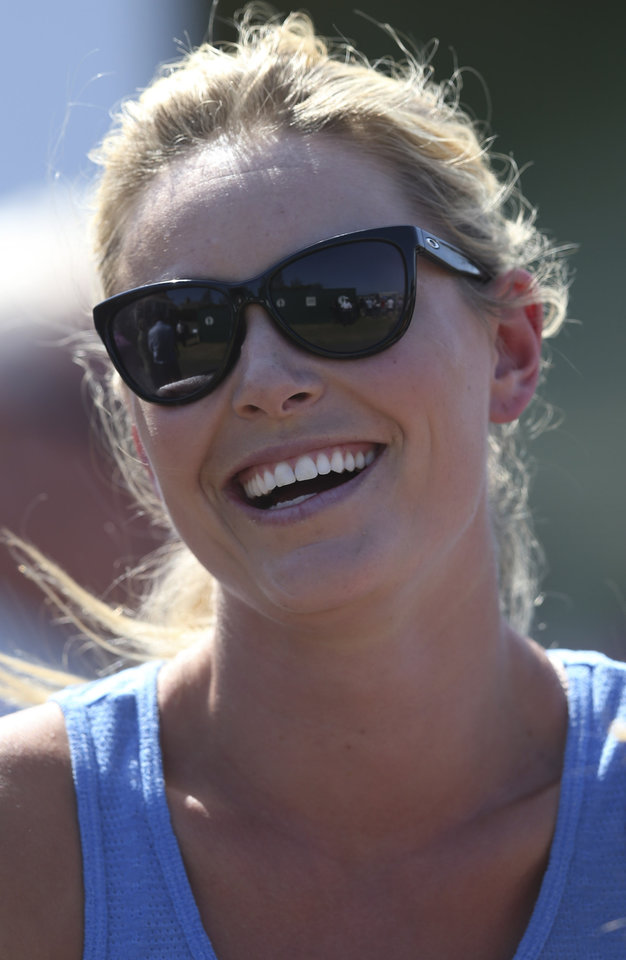 Photo - Skier Lindsey Vonn, girlfriend of Tiger Woods of the United States, watches the second round of the British Open Golf Championship at Muirfield, Scotland, Friday July 19, 2013. (AP Photo/Scott Heppell)