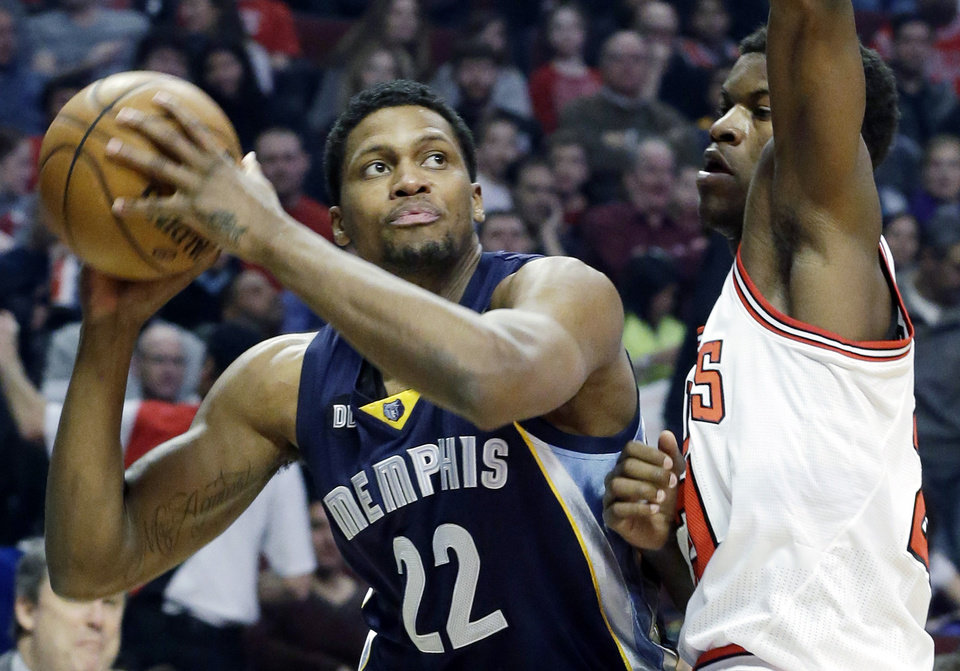 Memphis Grizzlies forward Rudy Gay, left, looks to the basket as Chicago Bulls guard Jimmy Butler guards during the first half of an NBA basketball game in Chicago on Saturday, Jan. 19, 2013. (AP Photo/Nam Y. Huh) ORG XMIT: CXA103