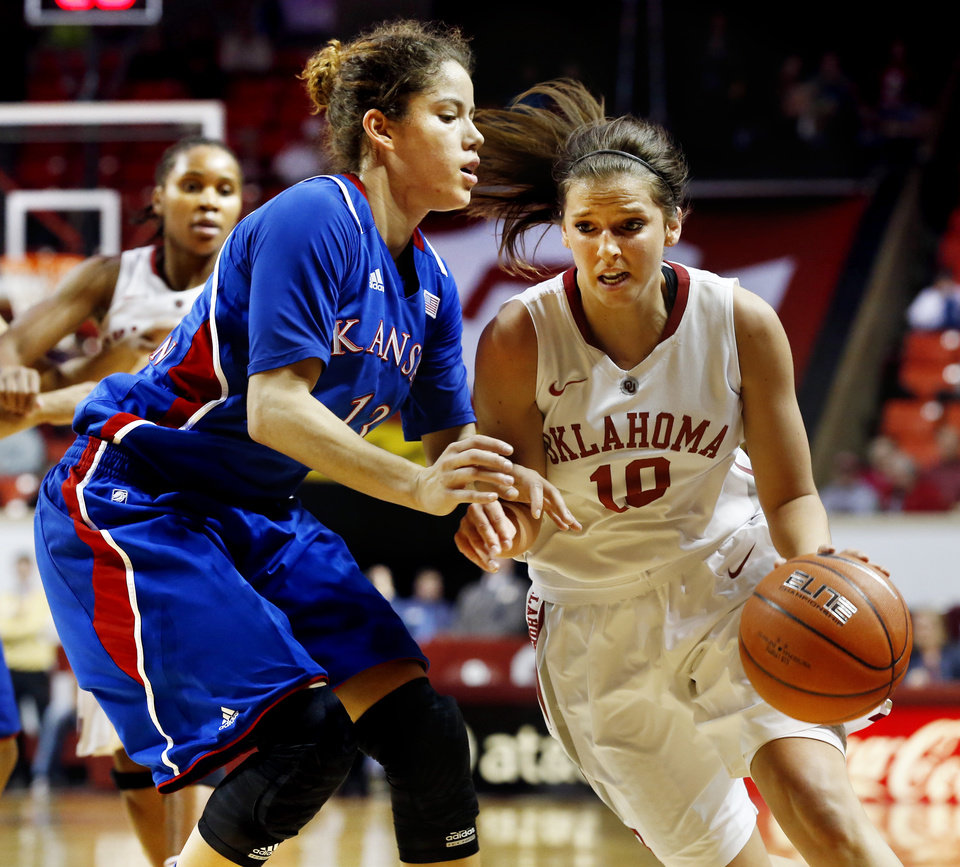 Photo - Kansas Jayhawks' Monica Engelman (13) defends Oklahoma Sooner's Morgan Hook (10) as the University of Oklahoma Sooners (OU) play the Kansas Jayhawks in NCAA, women's college basketball at The Lloyd Noble Center on Saturday, March 2, 2013  in Norman, Okla. Photo by Steve Sisney, The Oklahoman