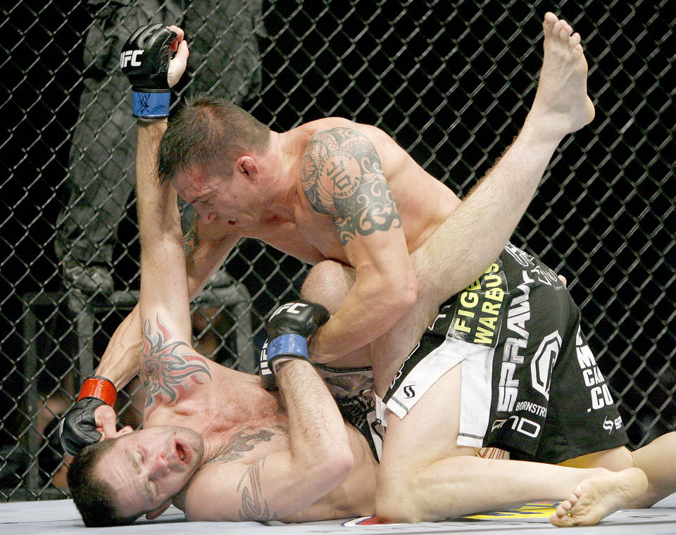 Photo - Nate Quarry, right, fights Tim Credeur during UFC Fight Night at the Cox Convention Center in Oklahoma City, Wednesday, September 16, 2009.  Photo by Bryan Terry, The Oklahoman