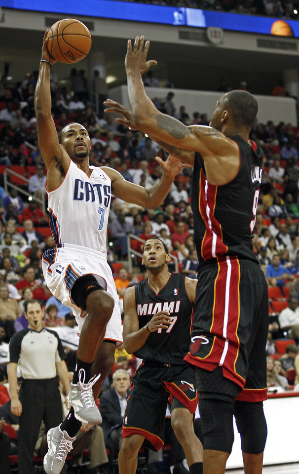 Photo -   Charlotte Bobcats' Ramon Sessions (7) drives to the basket as Miami Heat's Rashard Lewis (9) defends during the first half of an NBA preseason basketball game in Raleigh, N.C., Tuesday, Oct. 23, 2012. (AP Photo/Gerry Broome)