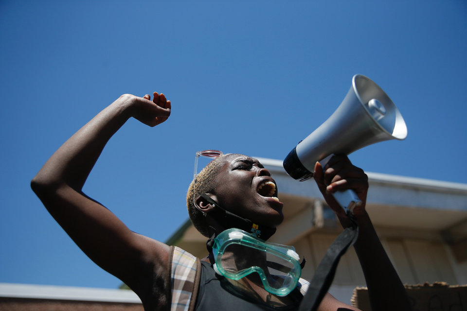 Photo - A speaker talks at the State capitol during a Black Lives Matter rally in Oklahoma City,  Sunday, May 31, 2020.  [Bryan Terry/The Oklahoman]