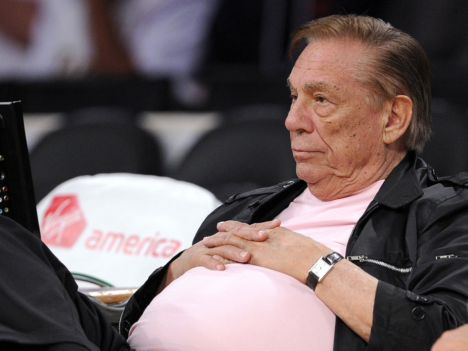 Photo - FILE - In this Oct. 17, 2010 file photo, Los Angeles Clippers team owner Donald Sterling watches his team play in Los Angeles. With a $2 billion sale of the Clippers hanging in the balance, a judge is set to determine Monday, June 30, 2014, if the terms of a family trust alone are enough to confirm Donald Sterling was properly removed as trustee and allow his estranged wife to sell the team without his consent.  (AP Photo/Mark J. Terrill, File)