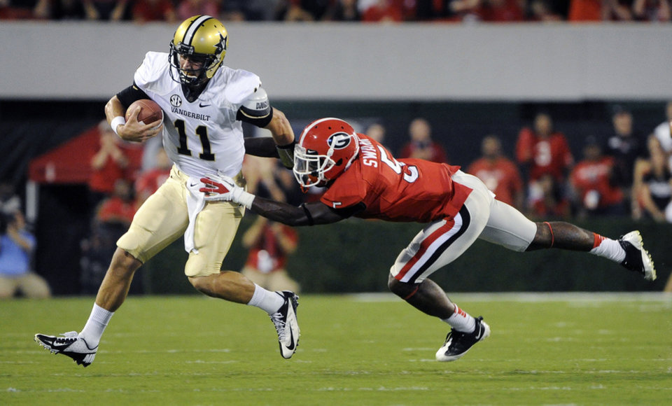 Photo -   Vanderbilt quarterback Jordan Rodgers (11) tries to avoid the defense of Georgia defensive back Damian Swann (5) during the first quarter of an NCAA college football game on Saturday, Sept. 22, 2012, in Athens, Ga. (AP photo/John Amis)
