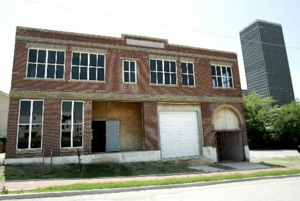 Photo - This three-story warehouse is being renovated on NE 2nd in Oklahoma City on Thursday, May 16, 2007. By John Clanton