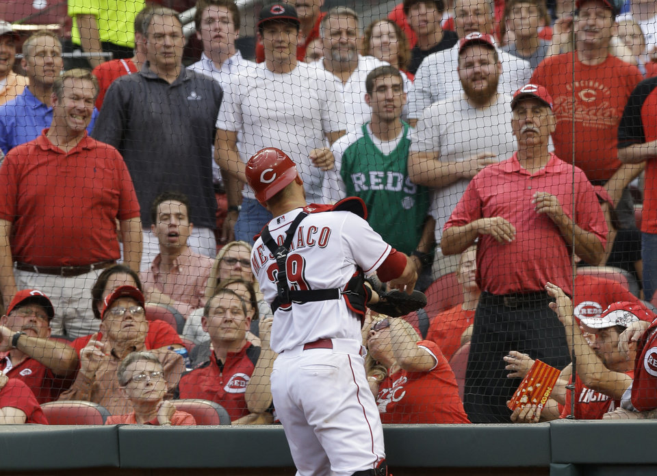 Photo - Cincinnati Reds catcher Devin Mesoraco can't reach a foul ball hit by Toronto Blue Jays' Brett Lawrie just behind the netting in the third inning of a baseball game, Friday, June 20, 2014, in Cincinnati. (AP Photo/Al Behrman)