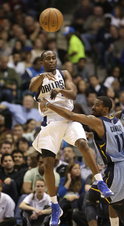 Dallas Mavericks point guard Rodrigue Beaubois, top, passes off against Memphis Grizzlies point guard Mike Conley (11) during the first half of an NBA basketball game on Saturday, Jan. 12, 2013, in Dallas. (AP Photo/LM Otero)