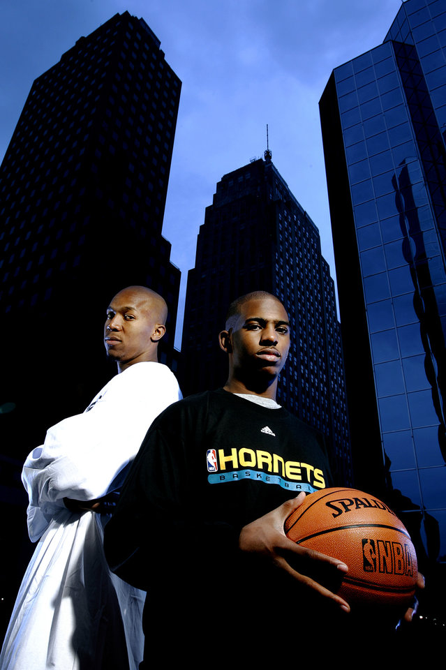 Photo - David West, left, and Chris Paul of the New Orleans/Oklahoma City Hornets NBA basketball team pose for a photo in downtown Oklahoma City, Monday, October 9, 2006.  By Bryan Terry, The Oklahoman ORG XMIT: KOD