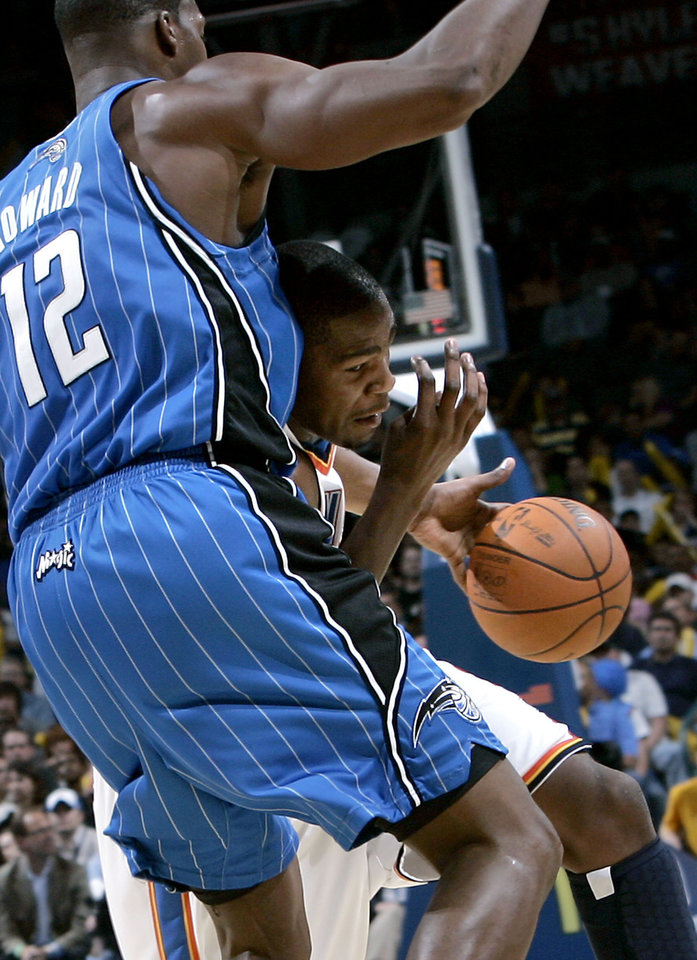 Oklahoma City's Kevin Durant runs into pressure from Orlando's Dwight Howard  during the NBA basketball game between the Orlando Magic and the Oklahoma City Thunder at the Ford Center in Oklahoma City, on Sunday, Nov. 8, 2009. The Thunder beat the Magic 102-74. By John Clanton, The Oklahoman