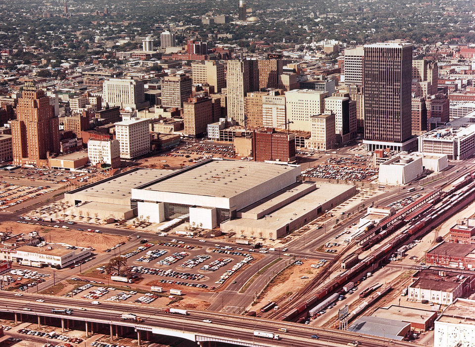 OKLAHOMA CITY / SKYLINE / AERIAL VIEW: Aerial view of downtown Oklahoma City taken in the early to mid 1970s, probably between late 1972 and late 1977. The Myriad Convention Center, seen in the center of this aerial photo, was dedicated in November of 1972. The Biltmore Hotel, seen in the upper left area of this photo, was demolished in October of 1977. View is looking northwest from E.K. Gaylord Blvd. and the Crosstown Expressway.