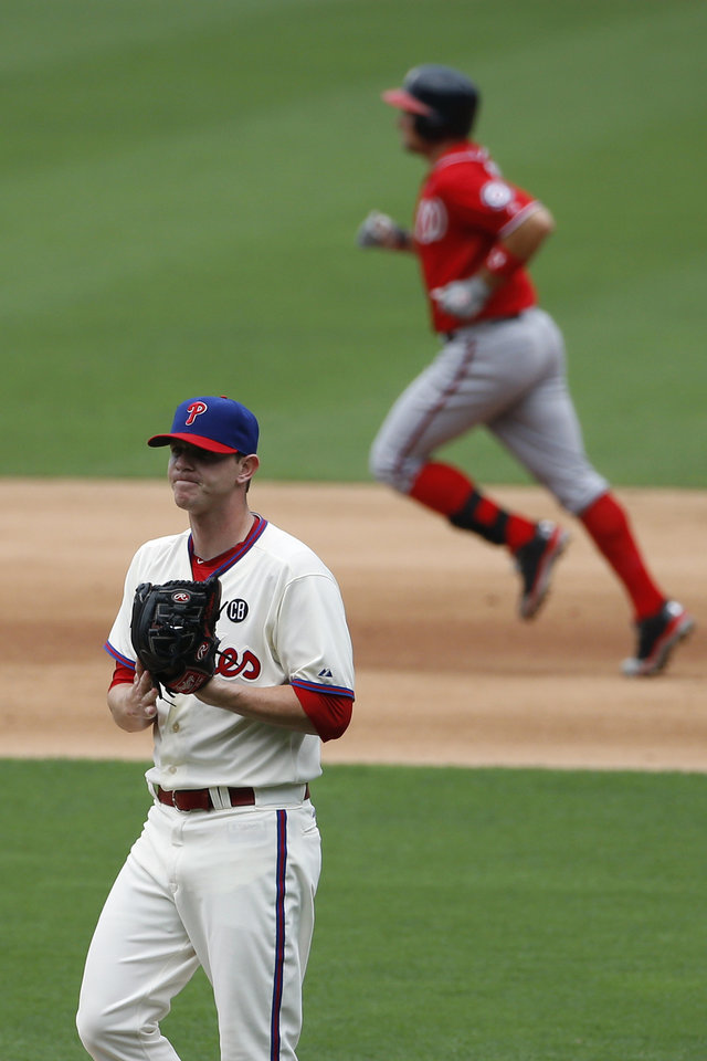 Photo - Philadelphia Phillies relief pitcher Justin De Fratus, left, reacts after giving up a home run to Washington Nationals' Ryan Zimmerman during the eighth inning of a baseball game, Sunday, July 13, 2014, in Philadelphia. Washington won 10-3. (AP Photo/Matt Slocum)