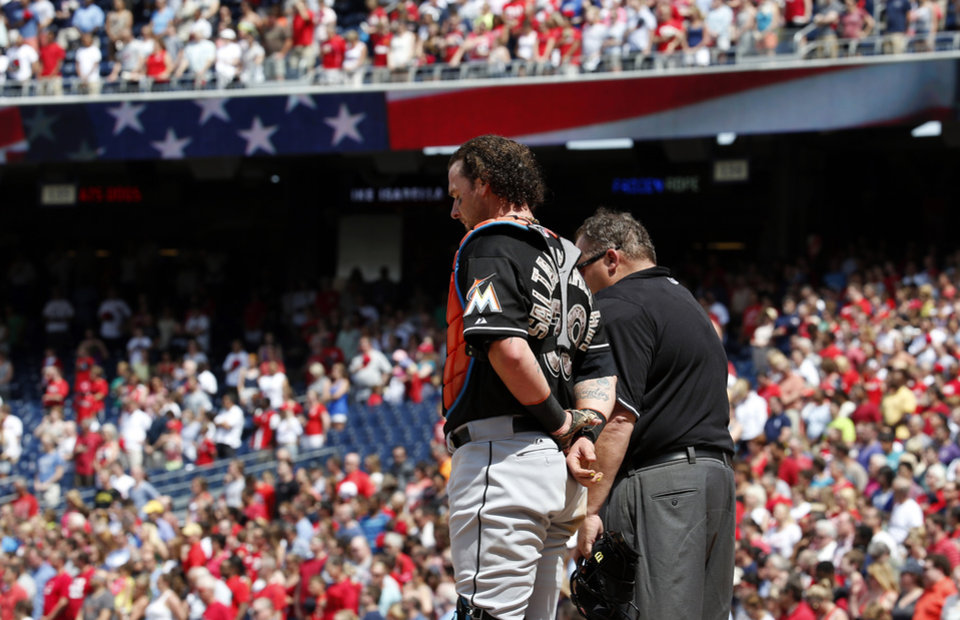 Photo - Miami Marlins catcher Jarrod Saltalamacchia, and umpire Fieldin Culbreth pause for the National Moment of Remembrance during a baseball game against the Washington Nationals, at Nationals Park, on Memorial Day, Monday, May 26, 2014, in Washington. (AP Photo/Alex Brandon)