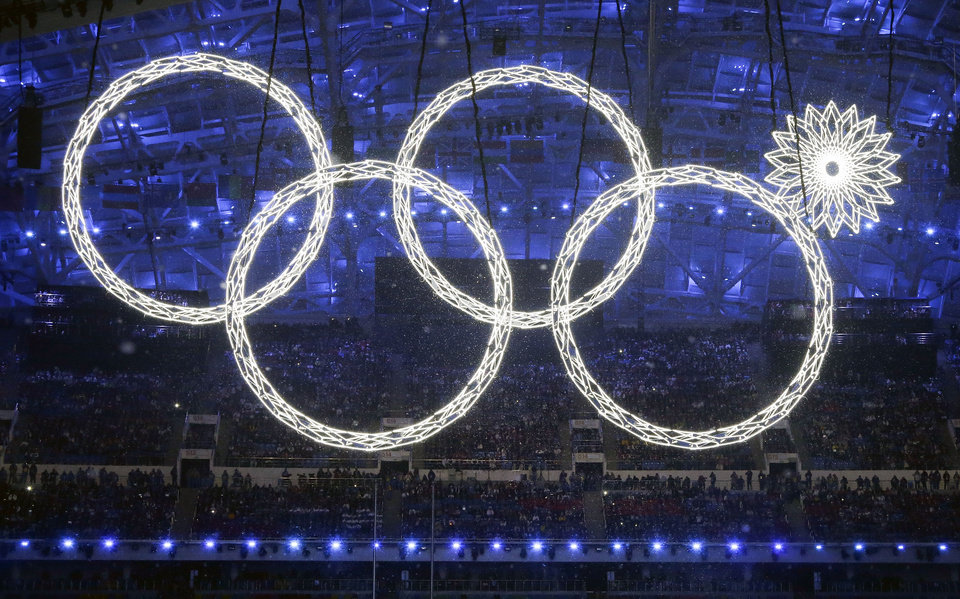Photo - One of the rings forming the Olympic Rings fails to open during the opening ceremony of the 2014 Winter Olympics in Sochi, Russia, Friday, Feb. 7, 2014. (AP Photo/Mark Humphrey)
