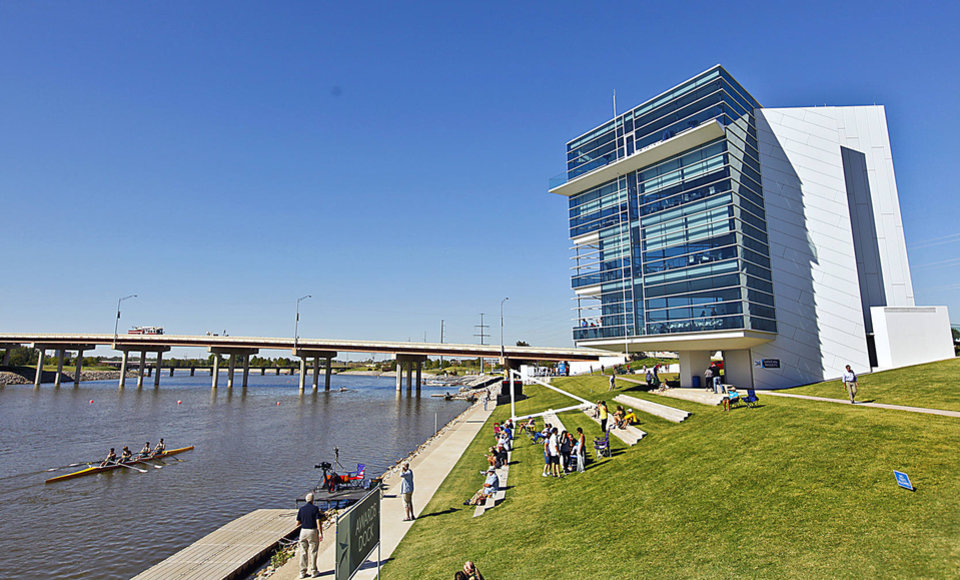 From the Chesapeake Finish Line Tower and the Devon Boathouse, spectators watch the 2011 Oklahoma Regatta Festival at the Oklahoma River.  PHOTO BY CHRIS LANDSBERGER, THE OKLAHOMAN ARCHIVES