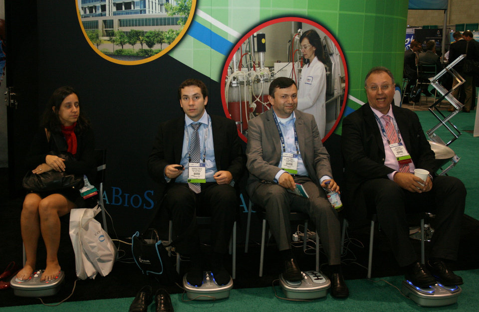 Photo - Foot massagers were really popular at the Oklahoma booth Wednesday at the BIO International convention in Boston. PHOTO BY JIM STAFFORD    unknown