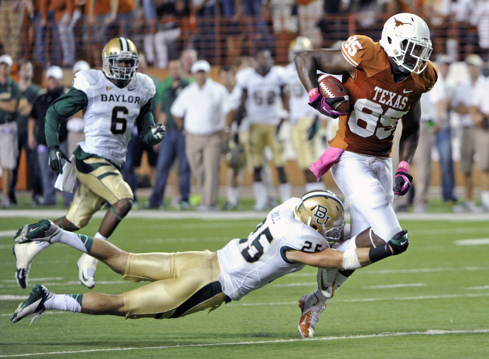 Photo -   Texas tight end M.J. McFarland (85) is tackled by Baylor safety Sam Holl (25) in the first quarter of an NCAA college football game on Saturday, Oct. 20, 2012, in Austin, Texas. (AP Photo/Michael Thomas)