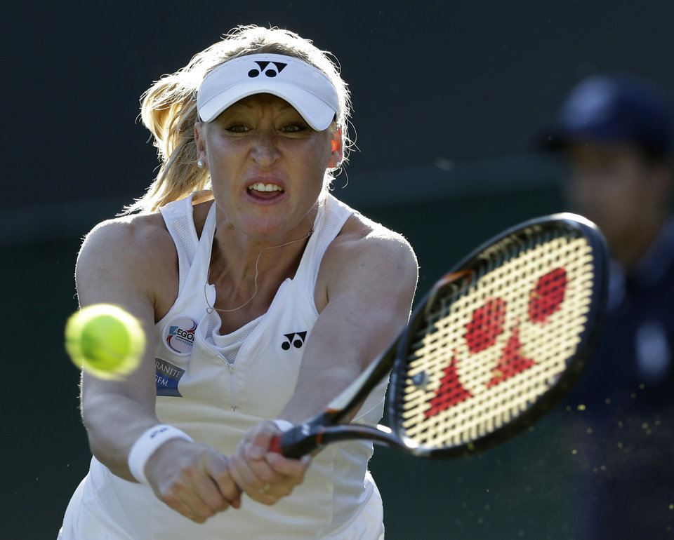 Photo - FILE - This is a Thursday June 28, 2012 file photo of Elena Baltacha of Britain as she returns a shot  to Petra Kvitova of the Czech Republic during a second round women's singles match at the All England Lawn Tennis Championships at Wimbledon, England. Former top-50 professional tennis player Elena Baltacha says she has been diagnosed with cancer of the liver.  In a statement on the British tennis federation's website Friday, March 7, 2014, the 30-year-old Baltacha says she is