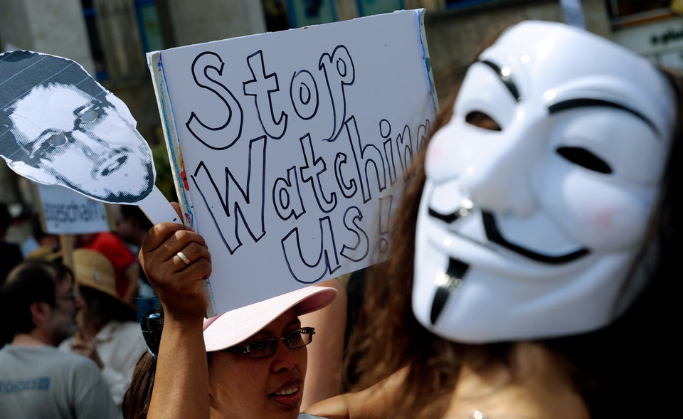 Photo - Protesters demonstrate against supposed NSA surveillance in Germany during a rally in Hannover, Germany, Saturday July 27, 2013.  (AP Photo/dpa, Peter Steffen)