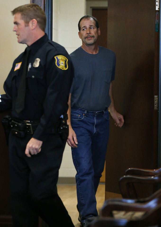Photo - Theodore P. Wafer, 54, of Dearborn Heights, appears at his arraignment in 20th District Court in Deaborn Heights, Mich., Friday, Nov. 15, 2013. Wafer faces second-degree murder and manslaughter charges in the death of 19-year-old Renisha McBride. (AP Photo/Paul Sancya)