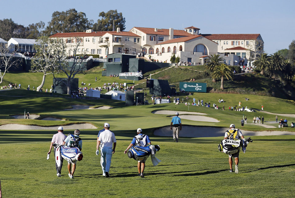 Photo - Players walk the ninth fairway during the second round of the Northern Trust Open golf tournament at Riviera Country Club in the Pacific Palisades area of Los Angeles, Friday, Feb. 14, 2014. (AP Photo/Reed Saxon)