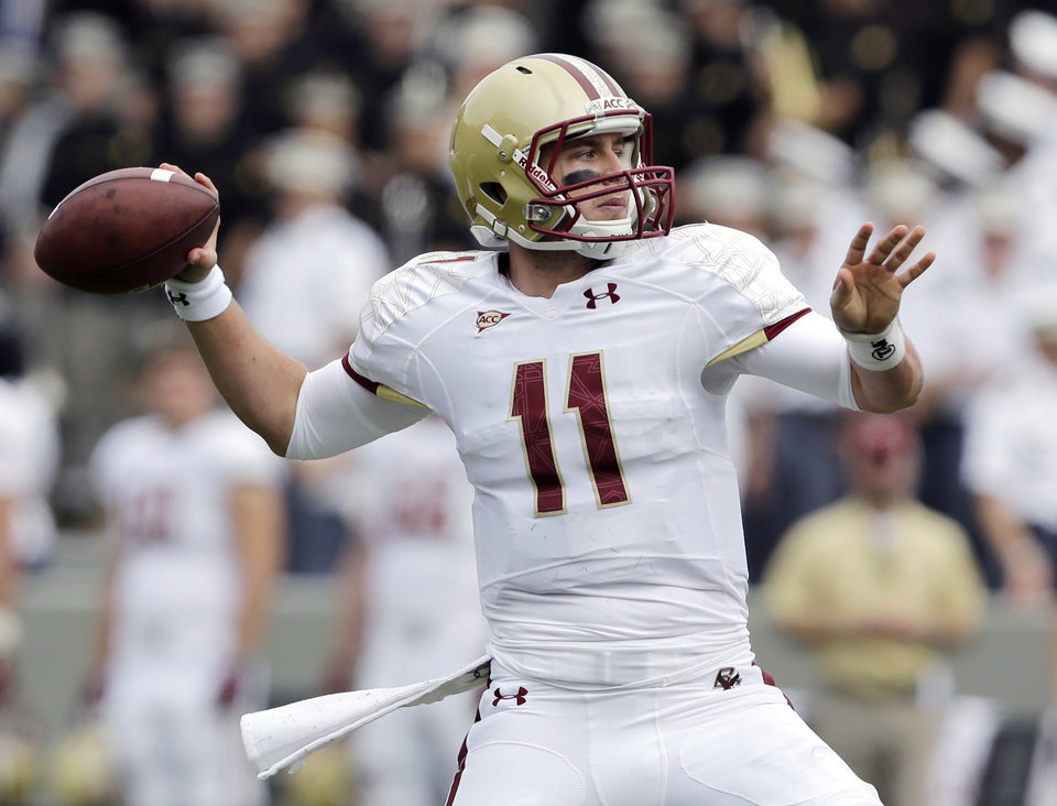 Photo -   Boston College quarterback Chase Rettig (11) passes against Army during the first half of an NCAA college football game Saturday, Oct. 6, 2012, in West Point, N.Y. (AP Photo/Mike Groll)