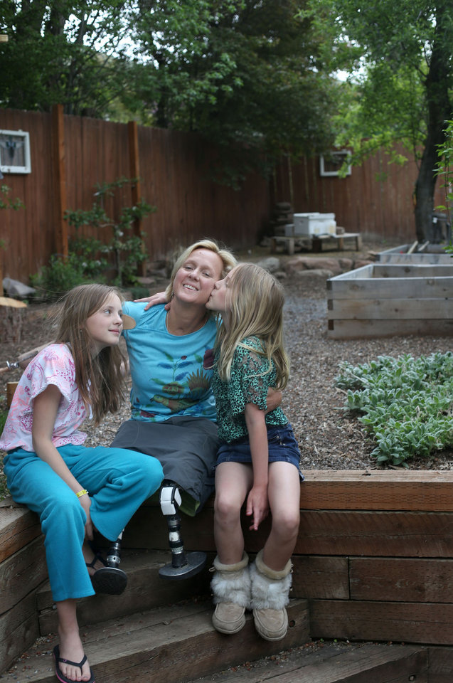 Photo -       Lisa Speckman sits with her daughters, Hannah, 11, and Lily, 9, in Salt Lake City on Monday, May 5, 2014.