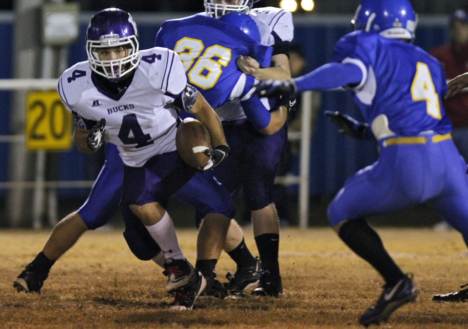 Hominy's Cody Pinkerton (4) looks to get past Dibble's Mike Coszalter (4) during the high school football playoff game between Dibble High School and Hominy High School at Dibble High School on Friday, Nov. 18, 2011. in Dibble, Okla.  Photo by Chris Landsberger, The Oklahoman