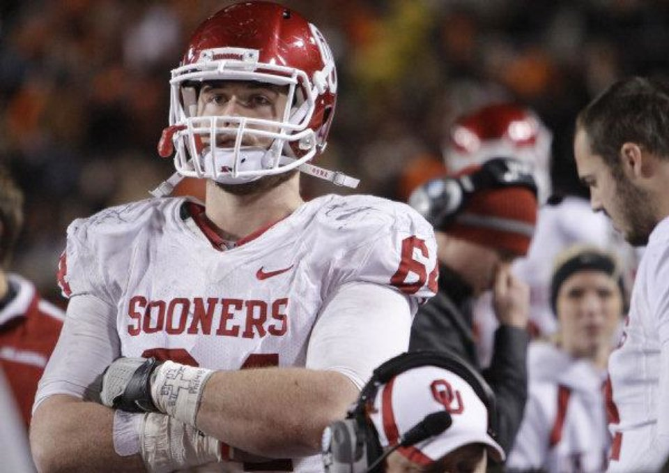Oklahoma's Gabe Ikard (64) looks on in the final minute of the Sooners 44-10 loss to OSU during the Bedlam college football game between the Oklahoma State University Cowboys (OSU) and the University of Oklahoma Sooners (OU) at Boone Pickens Stadium in Stillwater, Okla., Saturday, Dec. 3, 2011. Photo by Chris Landsberger, The Oklahoman <strong>CHRIS LANDSBERGER</strong>