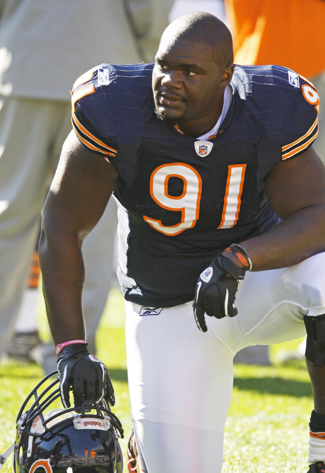 Tommie Harris and the Bears face Seattle in an NFC playoff game today.   AP photo