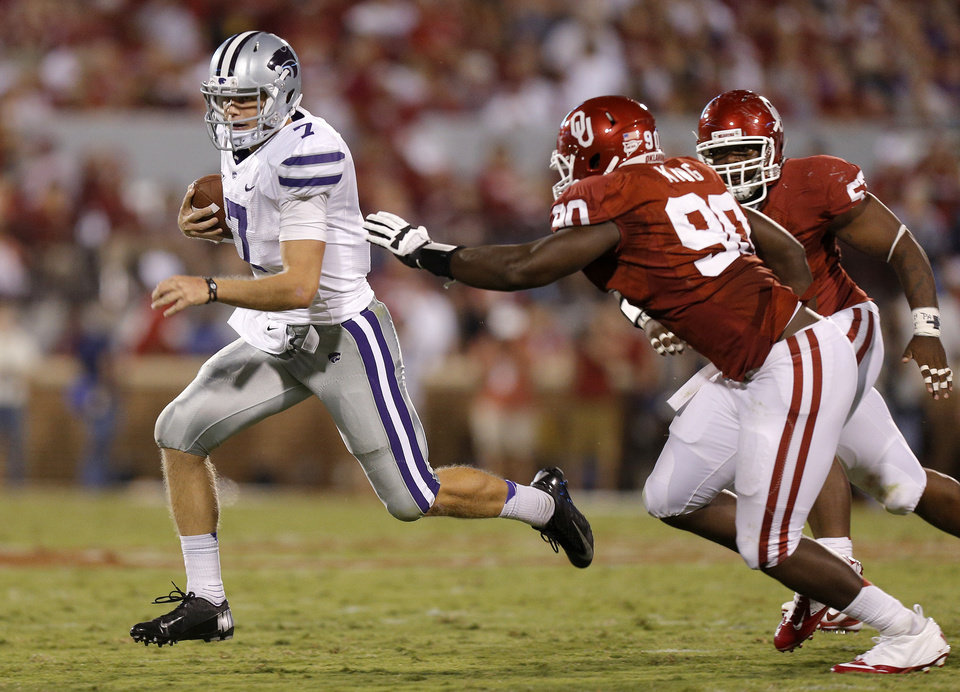 Photo - Kansas State's Collin Klein (7) runs past Oklahoma's David King (90) and Jaydan Bird during a college football game between the University of Oklahoma Sooners (OU) and the Kansas State University Wildcats (KSU) at Gaylord Family-Oklahoma Memorial Stadium, Saturday, September 22, 2012. Oklahoma lost 24-19. Photo by Bryan Terry, The Oklahoman