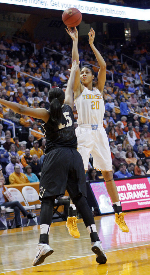 Photo - Tennessee center Isabelle Harrison (20) shoots over Vanderbilt guard Morgan Batey in the first half of an NCAA college basketball game, Monday, Feb. 10, 2014, in Knoxville, Tenn. (AP Photo/Wade Payne)