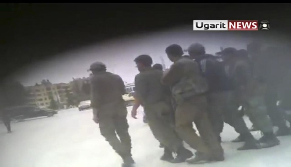 Photo -   This image made from amateur video released by Ugarit and accessed Thursday, May 3, 2012 purports to show Syrian security forces at Aleppo University in Aleppo, Syria. Syrian security forces stormed dormitories at Aleppo University to break up anti-government protests, killing at least four students and wounding several others in an hourslong rampage that ended Thursday morning and left part of the campus in flames, activists and opposition groups said. (AP Photo/Ugarit via AP video) TV OUT, THE ASSOCIATED PRESS CANNOT INDEPENDENTLY VERIFY THE CONTENT, DATE, LOCATION OR AUTHENTICITY OF THIS MATERIAL
