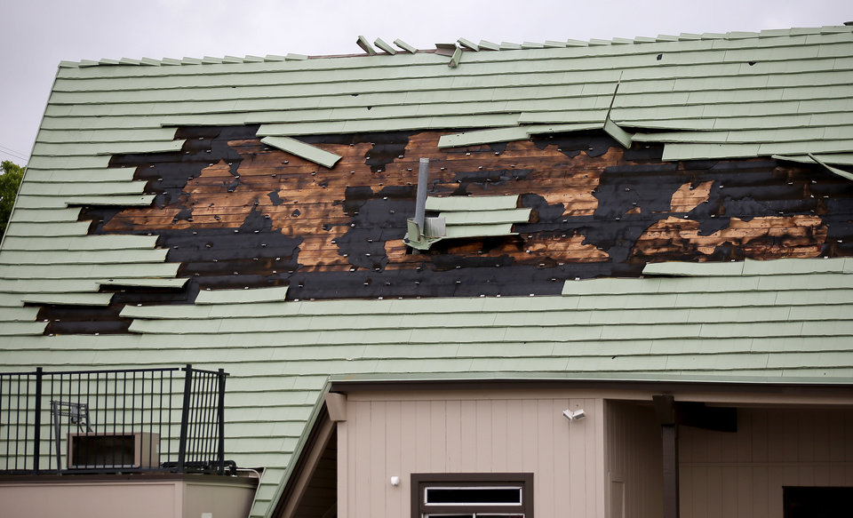 Photo - Damage to Mutts Amazing Hot Dogs And Burgers, 400 NW 23rd St., is pictured after an apparent tornado moved through the area in Oklahoma City, Sunday, May 26, 2019.  [Sarah Phipps/The Oklahoman]